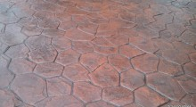 Stamped Concrete - Random Stone, Brick Red integral colour, Dark grey accent.