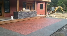 Random Stone Concrete Patio with Dark Grey Exposed Aggregate Borders